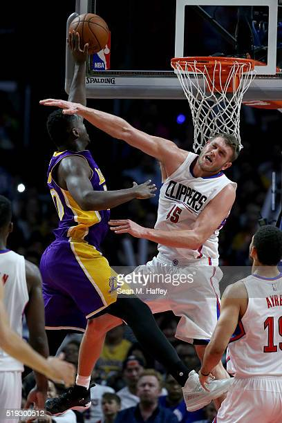 Julius Randle of the Los Angeles Lakers drives to the basket past Cole Aldrich of the Los Angeles Clippers during the second half of an NBA game...