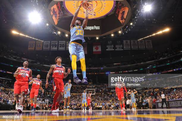 Julius Randle of the Los Angeles Lakers dunks the ball against the Washington Wizards on October 25 2017 at STAPLES Center in Los Angeles California...