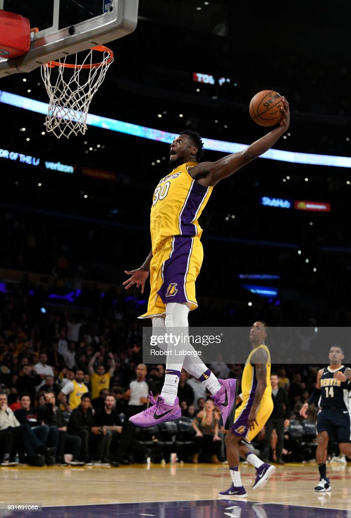 Julius Randle #30 of the Los Angeles Lakers dunks the ball against the Denver Nuggets on March 13, 2018 at STAPLES Center in Los Angeles, California.
