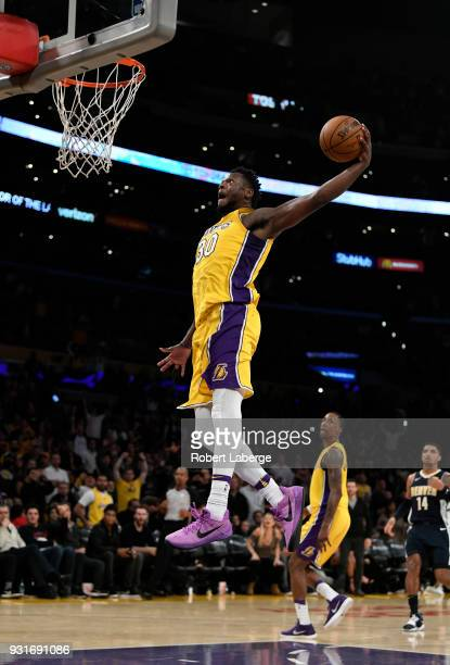 Julius Randle of the Los Angeles Lakers dunks the ball against the Denver Nuggets on March 13 2018 at STAPLES Center in Los Angeles California NOTE...