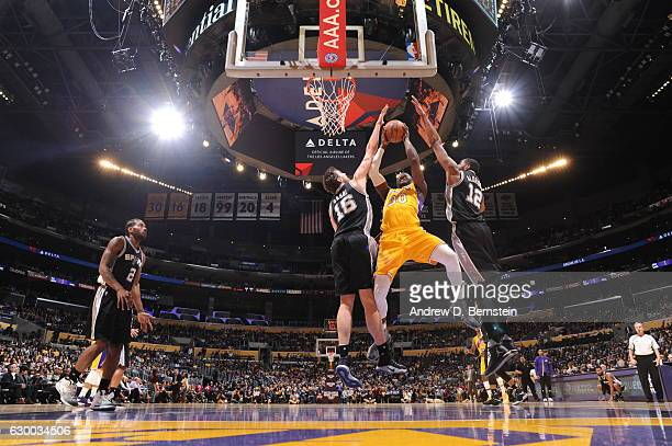 Julius Randle of the Los Angeles Lakers goes up for a lay up against the San Antonio Spurs on November 18 2016 at STAPLES Center in Los Angeles...
