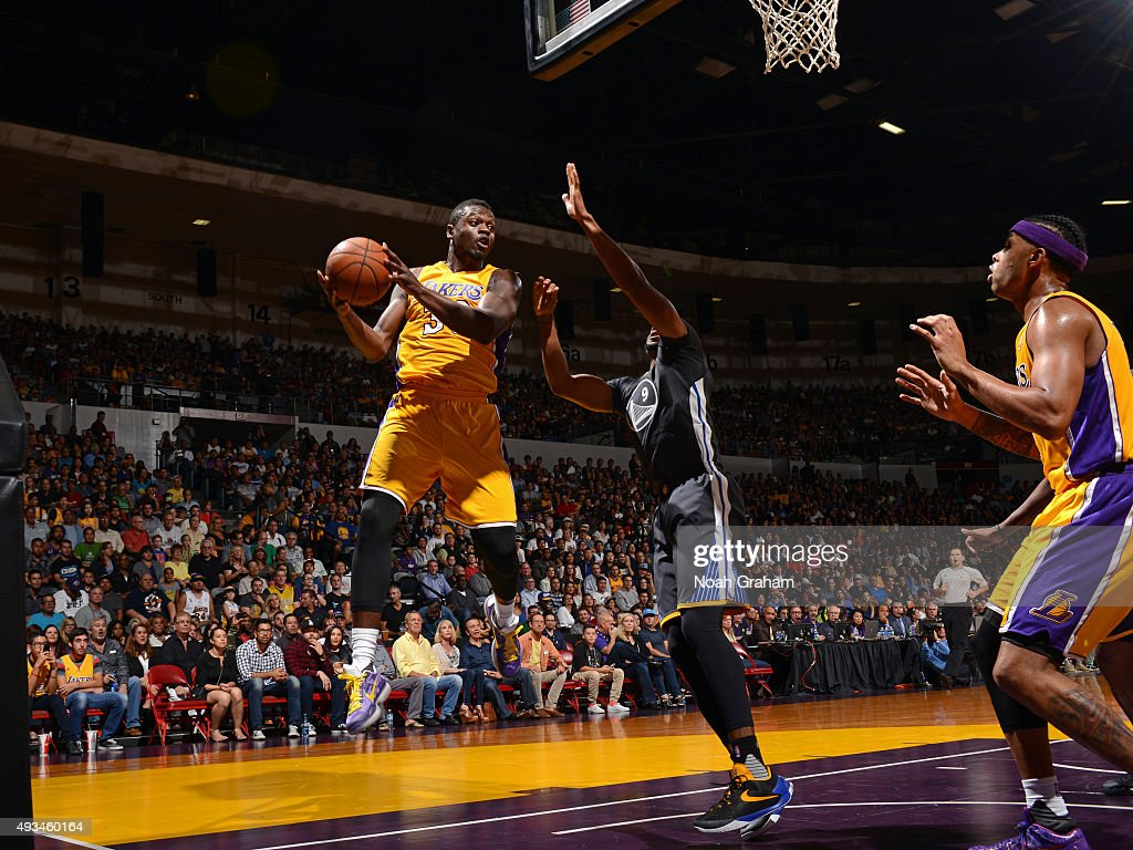 Julius Randle #30 of the Los Angeles Lakers grabs a rebound and looks to pass the ball against the Golden State Warriors during a preseason game on October 17, 2015 at Valley View Casino Center in San Diego, California.