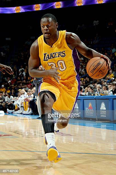 Julius Randle of the Los Angeles Lakers handles the ball during the game against the Golden State Warriors on October 12 2014 at Citizens Business...