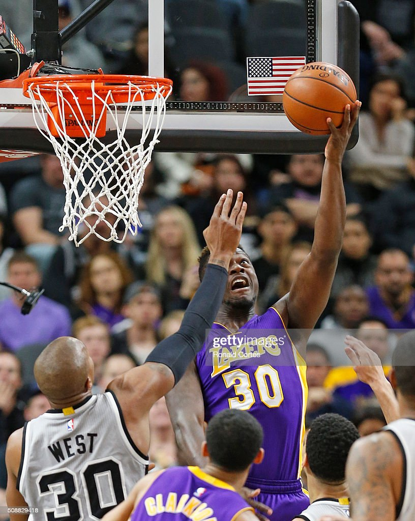 Julius Randle #30 of the Los Angeles Lakers scores over David West #30 of the San Antonio Spurs at AT&T Center on February 6, 2016 in San Antonio, Texas.