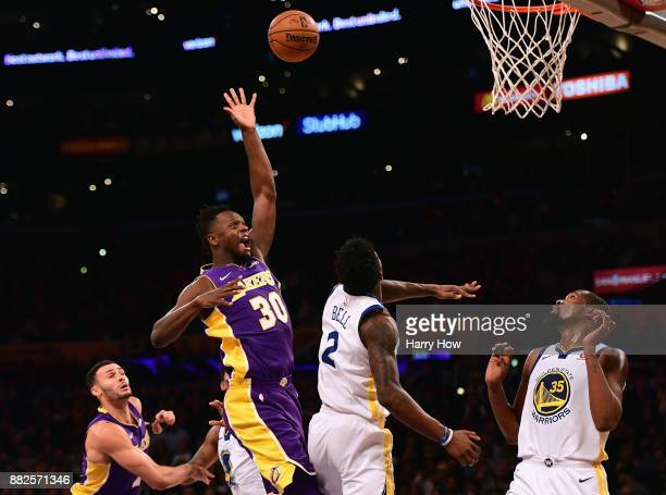 Julius Randle of the Los Angeles Lakers scores over Jordan Bell and Kevin Durant of the Golden State Warriors during a 127123 Warriors overtime win...