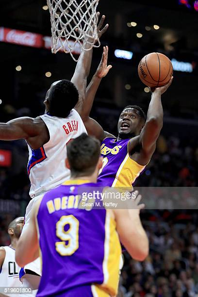 Julius Randle of the Los Angeles Lakers shoots over Jeff Green of the Los Angeles Clippers during an NBA game between Los Angeles Clippers vs Los...