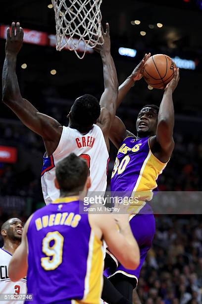 Julius Randle of the Los Angeles Lakers shoots past Jeff Green of the Los Angeles Clippers during the first half of an NBA game on April 5 2016 at...