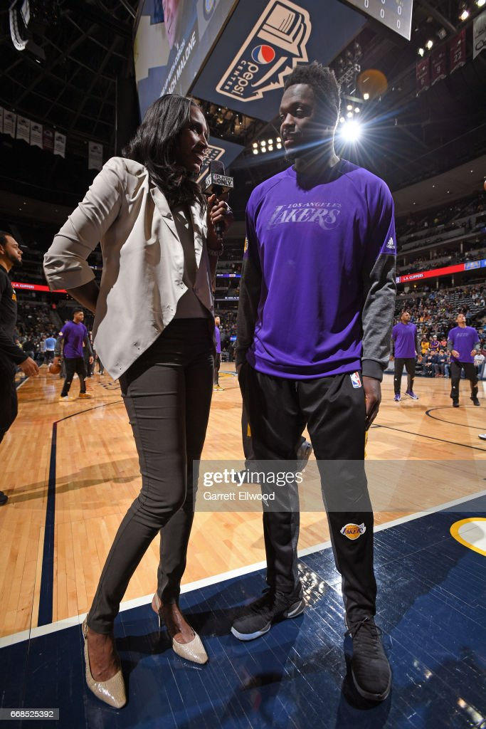 Julius Randle #30 of the Los Angeles Lakers talks with former WNBA player Lisa Leslie after the game against the Denver Nuggets on March 13, 2017 at the Pepsi Center in Denver, Colorado.
