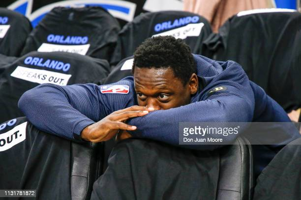 Julius Randle of the New Orlean Pelicans hides in the second row of seats during the teams introduction before playing the Orlando Magic at the Amway...