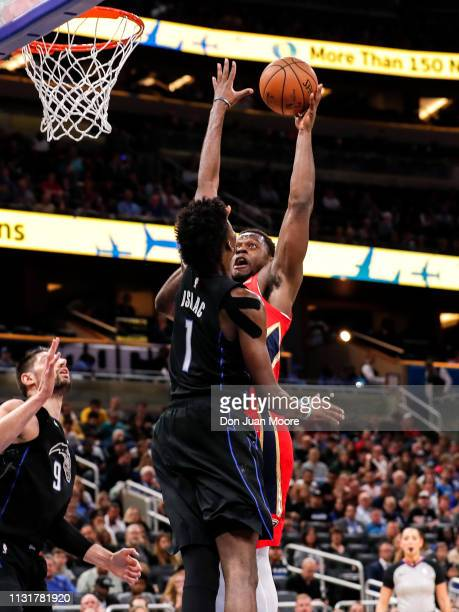Julius Randle of the New Orlean Pelicans shoots over Jonathan Isaac of the Orlando Magic during the game at the Amway Center on March 20 2019 in...