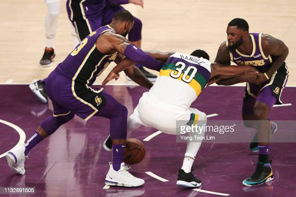Julius Randle of the New Orleans Pelicans competes for the ball against LeBron James and Lance Stephenson of the Los Angeles Lakers at Staples Center...