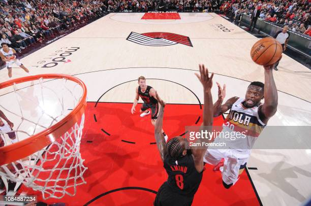 Julius Randle of the New Orleans Pelicans drives to the basket during the game against AlFarouq Aminu of the Portland Trail Blazers on January 18...