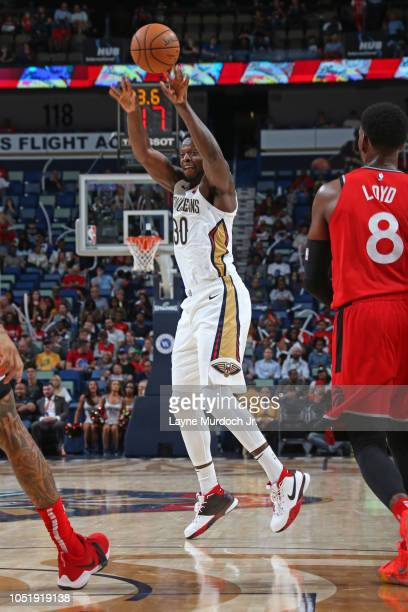 Julius Randle of the New Orleans Pelicans shoots a three point basket against the Toronto Raptors during a preseason game on October 11 2018 at...