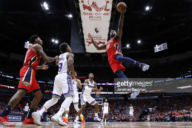 Julius Randle of the New Orleans Pelicans shoots over Yogi Ferrell of the Sacramento Kings during the first half at the Smoothie King Center on...