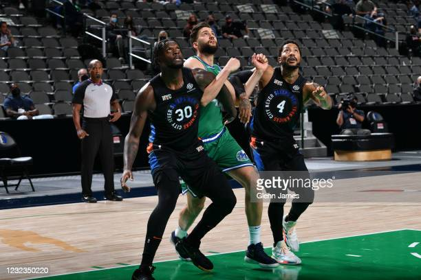 Julius Randle of the New York Knicks and Derrick Rose of the New York Knicks plays defense on Maxi Kleber of the Dallas Mavericks during the game on...