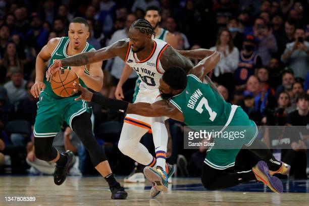 Julius Randle of the New York Knicks battles Grant Williams and Jaylen Brown of the Boston Celtics for the ball during the second hal at Madison...