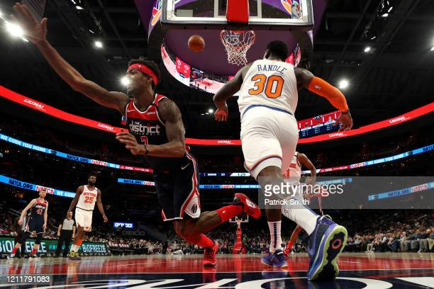 Julius Randle of the New York Knicks blocks the shot of Bradley Beal of the Washington Wizards during the first half at Capital One Arena on March 10...