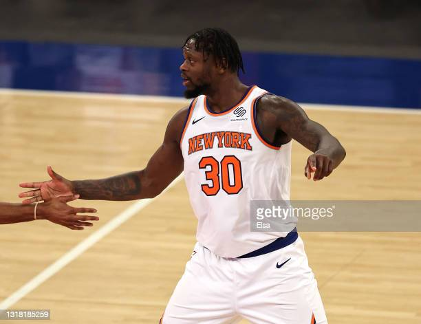 Julius Randle of the New York Knicks celebrates late in overtime after he fed the ball to Alec Burks and he shot a three pointer against the...