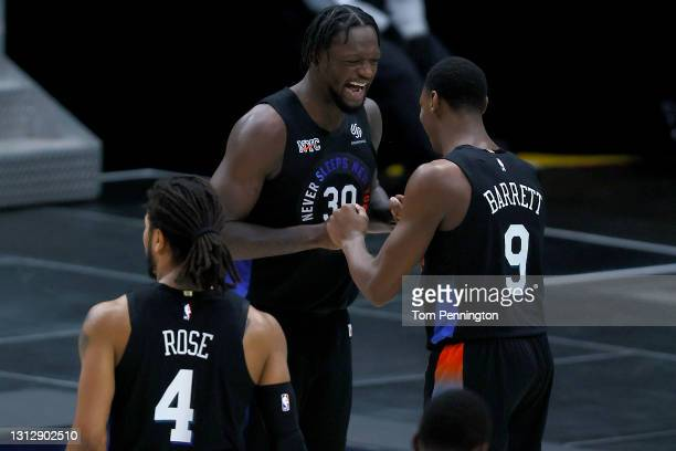 Julius Randle of the New York Knicks celebrates with RJ Barrett of the New York Knicks as the Knicks take on the Dallas Mavericks in the fourth...