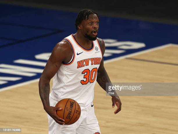 Julius Randle of the New York Knicks directs his teammates in the second quarter against the Charlotte Hornets at Madison Square Garden on May 15,...