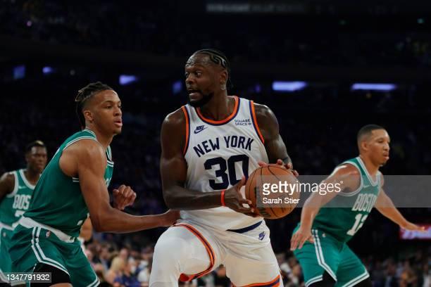 Julius Randle of the New York Knicks dribbles against Romeo Langford of the Boston Celtics during the first half against the Boston Celtics at...