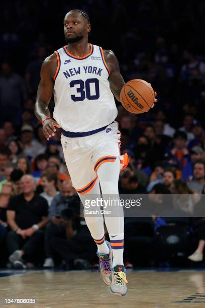 Julius Randle of the New York Knicks dribbles during the first half against the Boston Celtics at Madison Square Garden on October 20, 2021 in New...