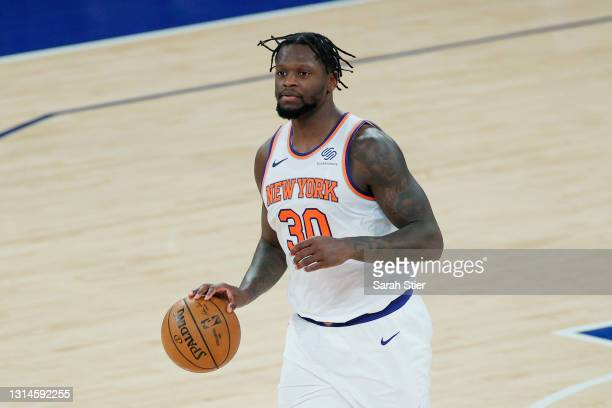 Julius Randle of the New York Knicks dribbles during the second half against the Charlotte Hornets at Madison Square Garden on April 20, 2021 in New...