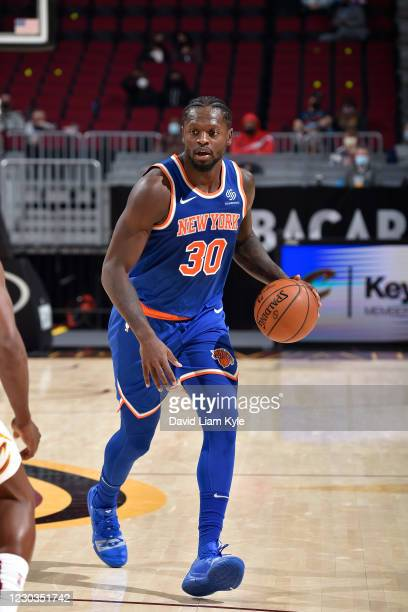 Julius Randle of the New York Knicks dribbles the ball during the game against the Cleveland Cavaliers on December 29, 2020 at Rocket Mortgage...