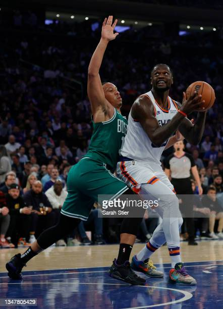 Julius Randle of the New York Knicks goes to the basket as Grant Williams of the Boston Celtics defends during the first half at Madison Square...