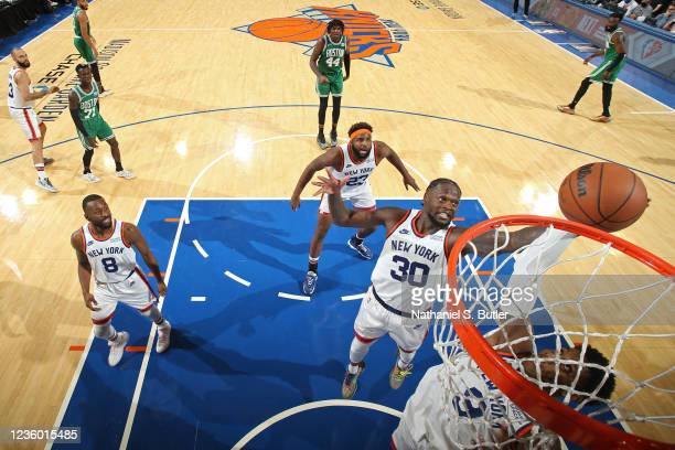 Julius Randle of the New York Knicks grabs a rebound against the Boston Celtics on October 20, 2021 at Madison Square Garden in New York, New York....