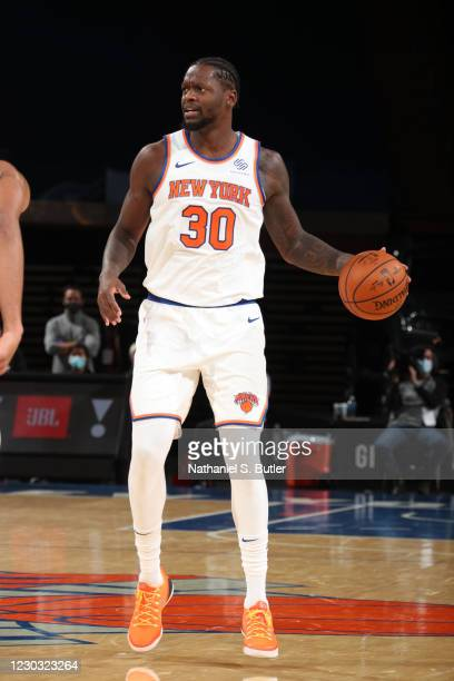 Julius Randle of the New York Knicks handles the ball during the game against the Milwaukee Bucks on December 27, 2020 at Madison Square Garden in...
