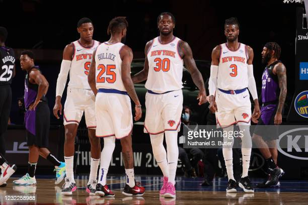 Julius Randle of the New York Knicks hi-fives his teammates during the game against the Toronto Raptors on April 11, 2021 at Madison Square Garden in...
