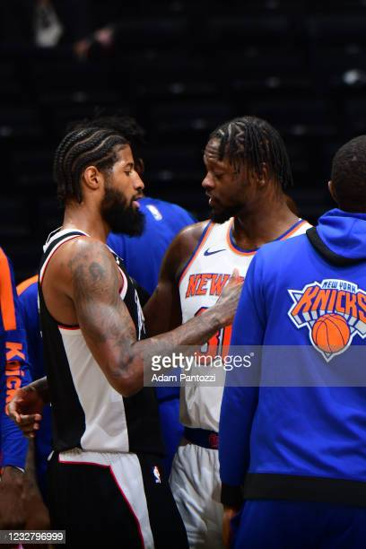 Julius Randle of the New York Knicks hi-fives Paul George of the LA Clippers after the game on May 9, 2021 at STAPLES Center in Los Angeles,...