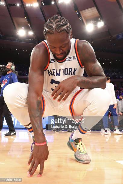 Julius Randle of the New York Knicks kneels on the court after the game against the Boston Celtics on October 20, 2021 at Madison Square Garden in...