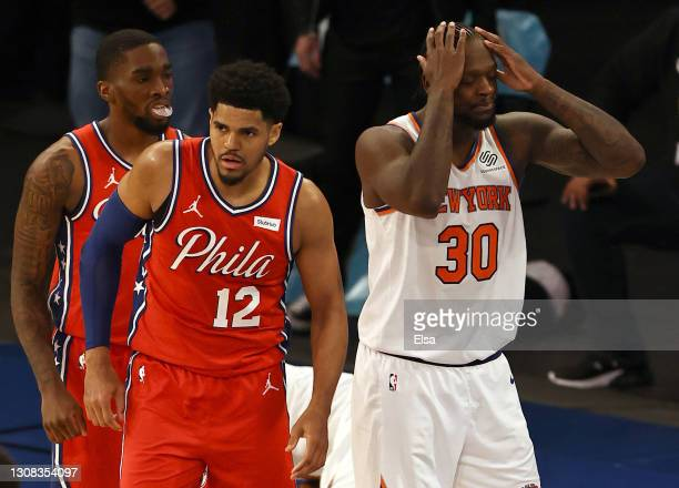 Julius Randle of the New York Knicks reacts after he is called for fouling Tobias Harris of the Philadelphia 76ers in the final seconds of overtime...