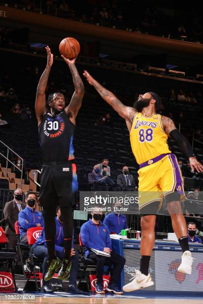 Julius Randle of the New York Knicks shoots a three point basket during the game against the Los Angeles Lakers on April 12, 2021 at Madison Square...