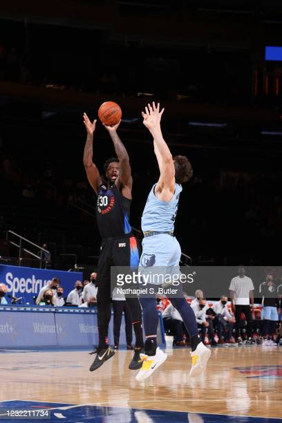 Julius Randle of the New York Knicks shoots a three pointer during the game against the Memphis Grizzlies on April 9, 2021 at Madison Square Garden...