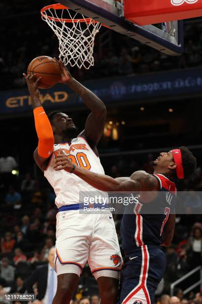 Julius Randle of the New York Knicks shoots on Bradley Beal of the Washington Wizards during the first half at Capital One Arena on March 10 2020 in...
