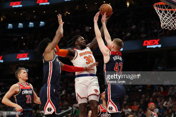 Julius Randle of the New York Knicks shoots on Davis Bertans of the Washington Wizards during the first half at Capital One Arena on March 10 2020 in...