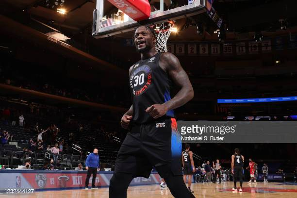 Julius Randle of the New York Knicks smiles and runs up court against the New Orleans Pelicans on April 18, 2021 at Madison Square Garden in New York...