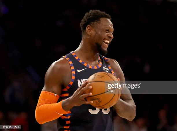 Julius Randle of the New York Knicks smiles as he runs out the clock in the final minute of the game against the Chicago Bulls at Madison Square...