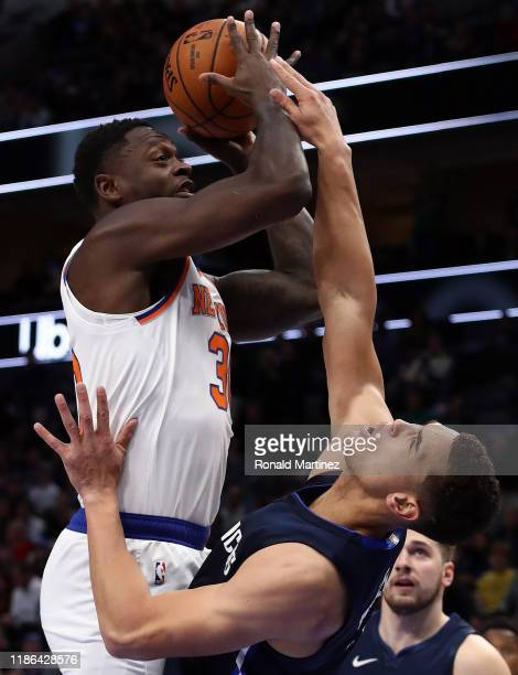 Julius Randle of the New York Knicks takes a shot against Dwight Powell of the Dallas Mavericks in the first half at American Airlines Center on...