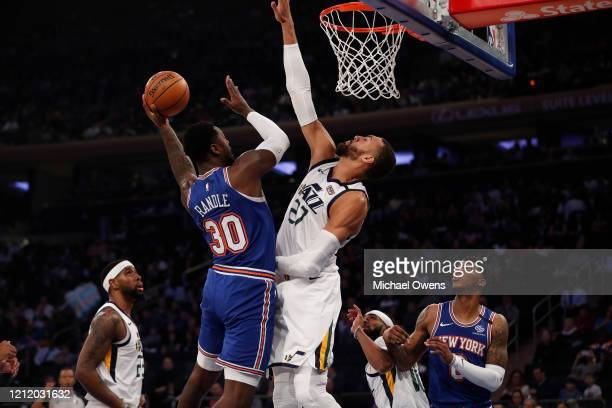 Julius Randle of the New York Knicks takes a shot against Rudy Gobert of the Utah Jazz during their game at Madison Square Garden on March 04 2020 in...