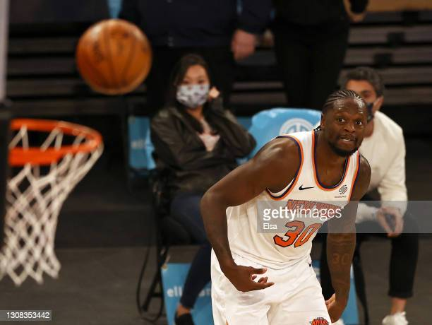 Julius Randle of the New York Knicks watches his last second shot pop out of the net givving the Philadelphia 76ers the win at Madison Square Garden...