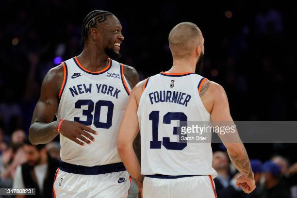 Julius Randle reacts with Evan Fournier of the New York Knicks during second overtime against the Boston Celtics at Madison Square Garden on October...