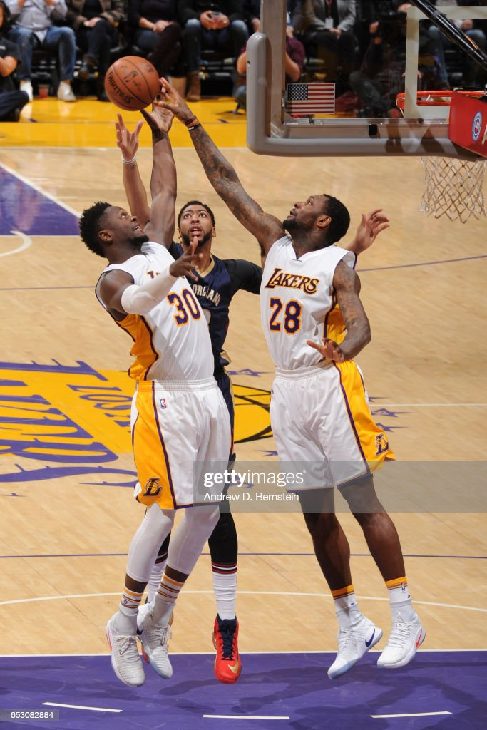 Julius Randle #30, Tarik Black #28 of the Los Angeles Lakers, and Anthony Davis #23 of the New Orleans Pelicans goes up for a rebound on March 5, 2017 at STAPLES Center in Los Angeles, California.