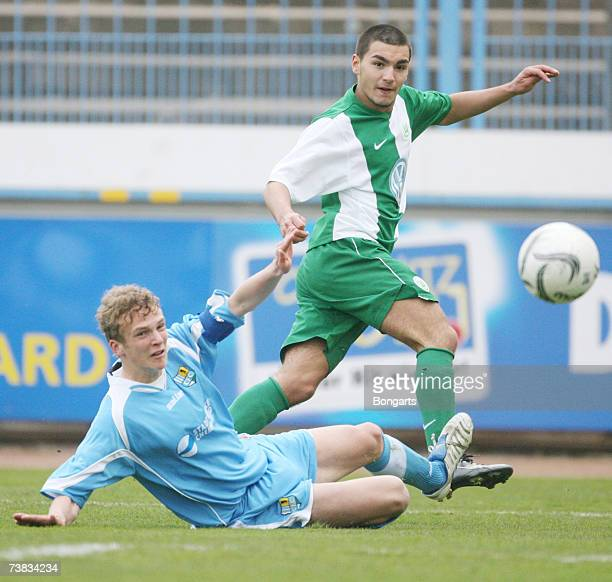 Julius Reinhadt of Chemnitzer FC fights for the ball with Sueleyman Chelikyurt of Wolfsburg the DFB Juniors German Cup semi final Match between...