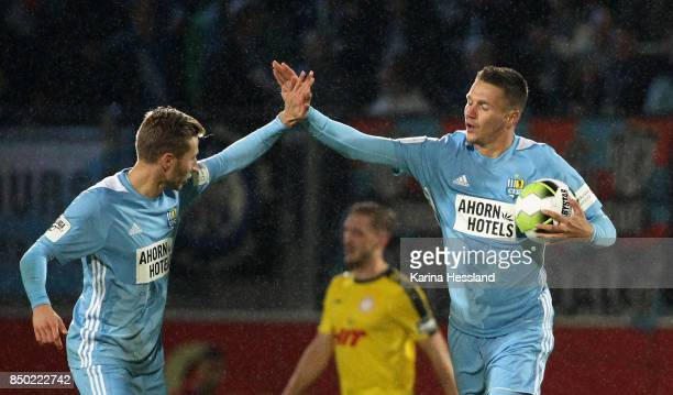 Julius Reinhardt and Daniel Frahn of Chemnitz celebrate the second goal by Daniel Frahn during the 3Liga match between Chemnitzer FC and SC Fortuna...