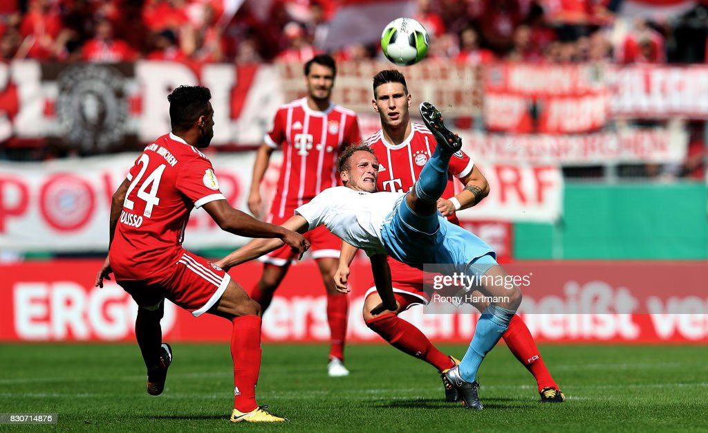 Julius Reinhardt (C) of Cottbus vies with Corentin Tolisso (L) and Niklas Suele (R) of Muenchen during the DFB Cup first round match between Chemnitzer FC and FC Bayern Muenchen at community4you Arena on August 12, 2017 in Chemnitz, Germany.