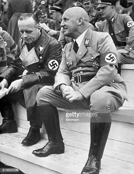 Julius Streicher and Joachim Von Ribbentrop sit side by side at a Nazi Ceremony This photo was found in Streicher's personal files at his estate at...